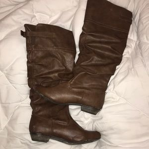 Brown knee-hi boots with small heel